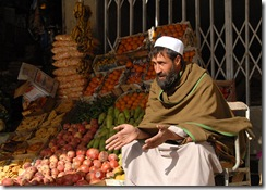 MAIDEN SHAHR, Afghanistan--A fruit and vegetable vendor sits outside his store in the Wardak Province central market on Dec. 9, 2008. ISAF photo by U.S. Navy Petty Officer 2nd Class Aramis X. Ramirez (RELEASED)