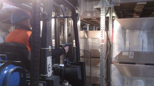 Photo 2: Storekeeper scanning pallet labels