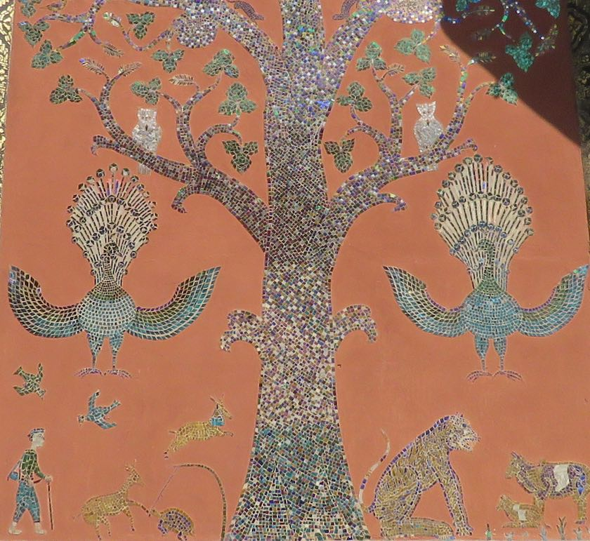 wall mosaic with tree, animals and people