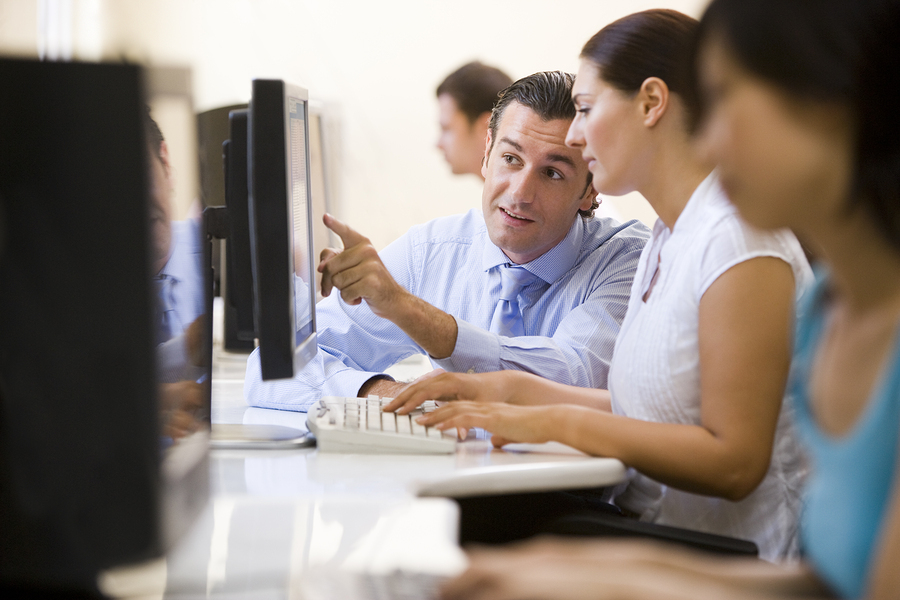 Man Assisting Woman In Workflow modelling