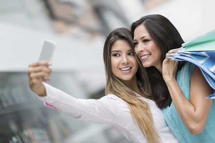 iStock_65248119_LARGE_Two_girls_taking_selfie_resized.png