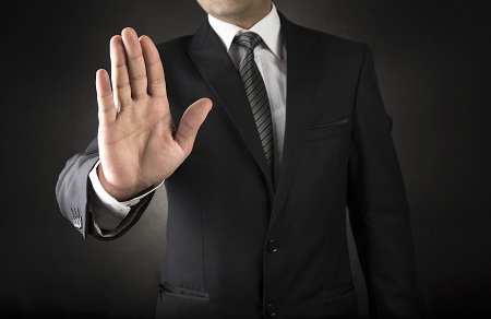 iStock_75743101_LARGE_business_man_saying_stop_resized.png