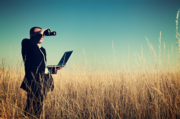 Man in field with binoculars_iStock-184320883_resized.png