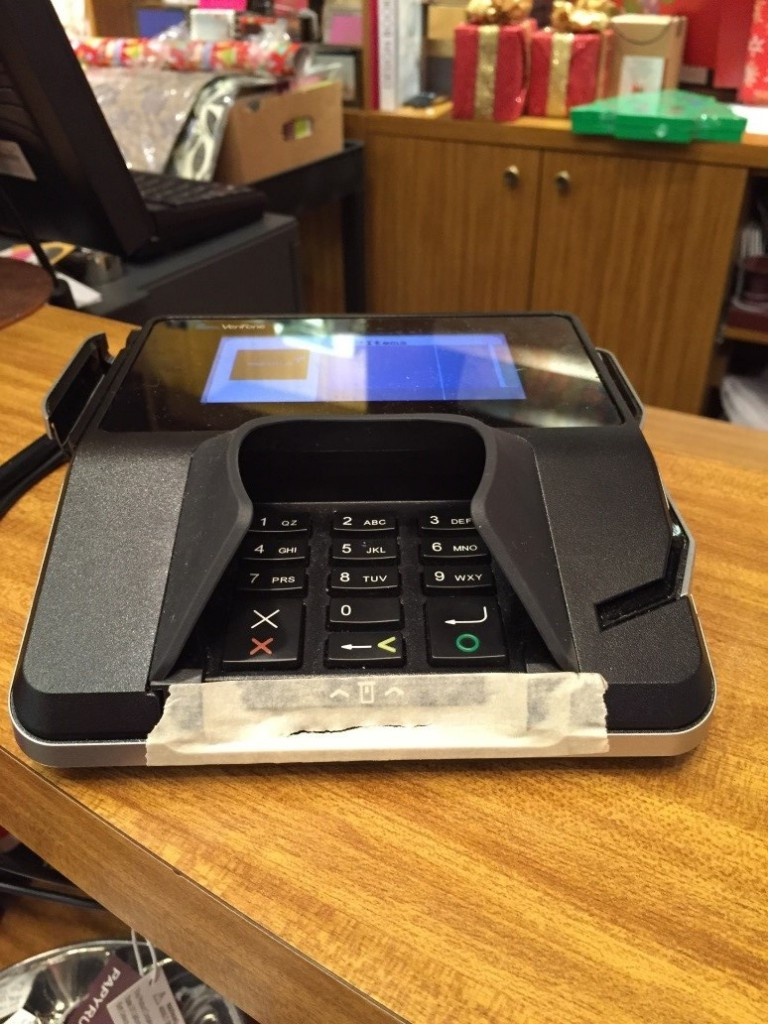 Card machine with tape covering chip slot