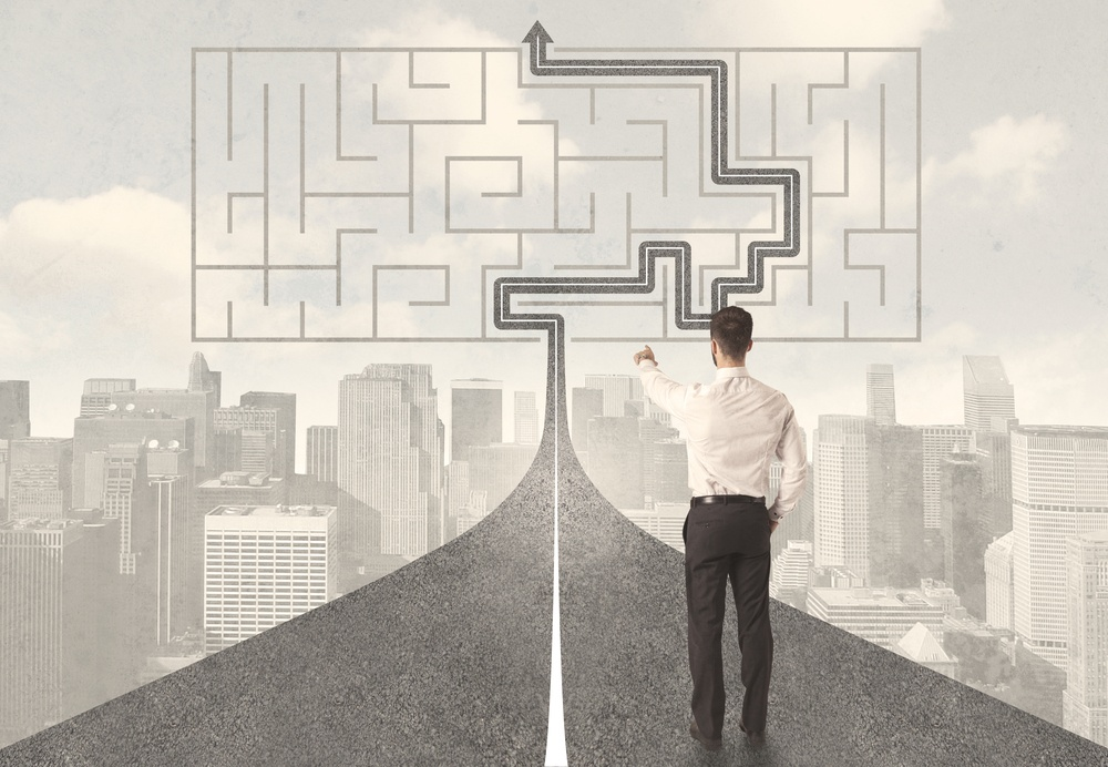 Businessman looking at road with maze and solution concept-1.jpeg