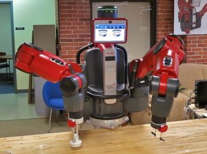 Rethink Robotics' Baxter, an innovative 2-arms cobot with 7 degrees of freedom per arm. The eyes in the computer screen move in the direction one of its arms is about to take. Photo credit: Steve Jurvetson