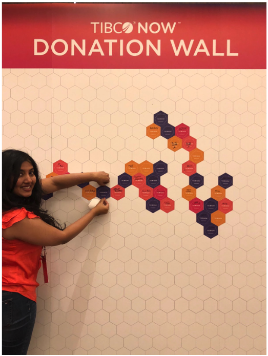 A conference participant adds her name to the Donation Wall at TIBCO NOW